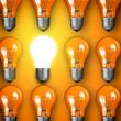 Concept for big idea. Glowing light bulb on orange background