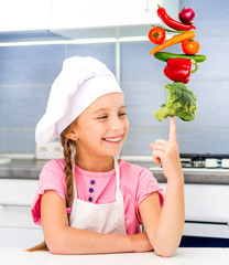 little girl balanced pyramid of vegetables