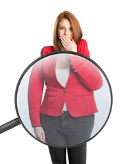 Woman's body magnified with magnifying glass