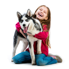 little girl is with husky dog