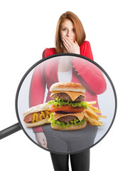 Woman's belly with food under a magnifying glass