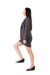 Asian business woman walking on stairs
