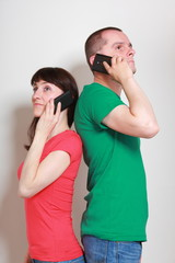 Woman and man talking on mobile phone