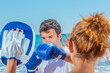 canvas print picture - Couple training boxing on the beach