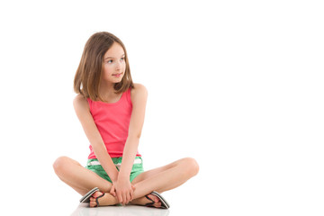 Pensive girl sitting with legs crossed