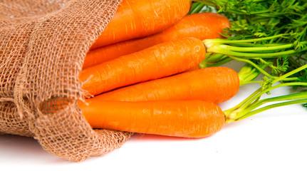 Fresh carrots in juta bag