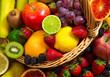 Mix of fresh fruits on wicker bascket - 67389758