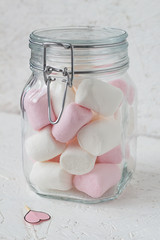 Marshmallows in a Glass Jar and a Paper Heart on a Stick