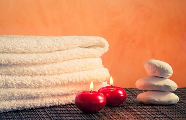 Spa massage border with towel stacked stone and red candles