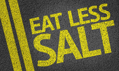 Eat Less Salt written on the road