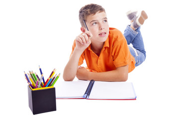 Pensive school kid looking up, isolated over white background