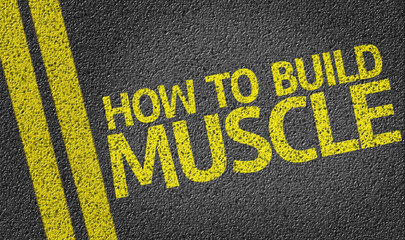 How to Build Muscle written on the road