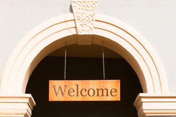 Welcome sign hanging in a door
