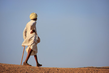 Local man walking on a hill, Khichan village, India