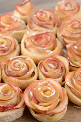 Tasty  puff pastry with apple shaped roses on table close-up
