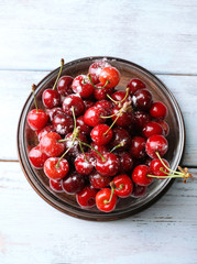 Sweet cherries on wooden table