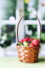 Forest berries in wicker basket,
