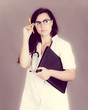 medical doctor woman with stethoscope.   A female doctor with a