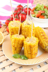 Grilled corn cobs on table, close-up
