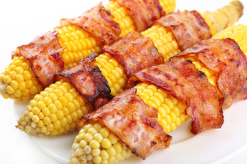 Grilled bacon wrapped corn, close-up