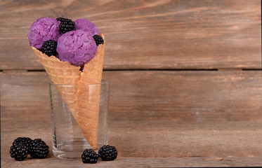 Tasty ice cream with berries in waffle cone