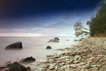 rocks into the sea. Elements of this image furnished by NASA
