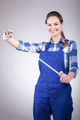 Smiling woman with tape measure