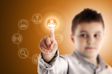 Network. Boy pressing a virtual touch screen. Orange background.