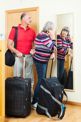 mature  couple with luggage
