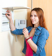 Young cute woman with light-switch