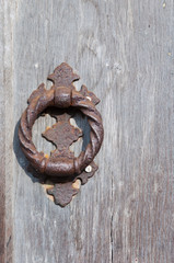 Vertical photo of door knocker and wooden door