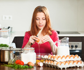 housewife  with eggs in  kitchen