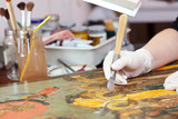 restoration of  Christian icon with agate burnisher poster