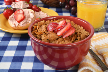 Bran flakes cereal with strawberries