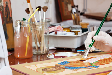 Icon-painter makes new Christian icon with Christ