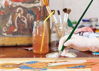 Artist works on new icon with brush
