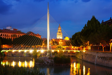 Footbridge over Segura  with Cathedral in background in night
