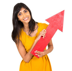 young indian woman holding red arrow