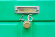 Close up of green door number 46