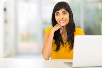 indian woman sitting in front of laptop