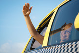 Fototapety woman in taxi waving hand out of car window
