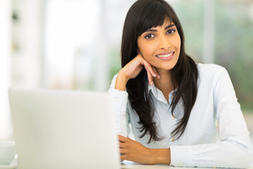 young indian businesswoman sitting in office
