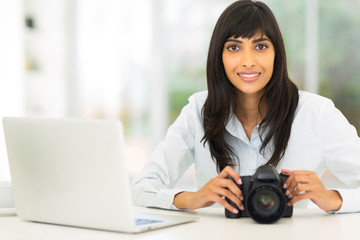 female indian photographer in office