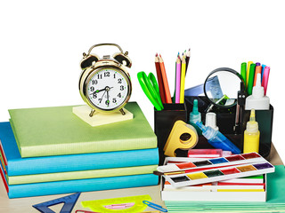 alarm clocks and school supplies isolated