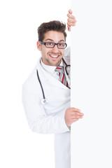 Happy Male Doctor Displaying Billboard