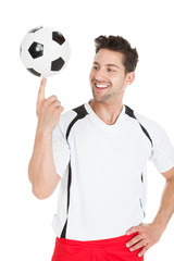Football Player Spinning Ball