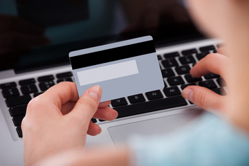 Woman Shopping Online With Credit Card And Laptop