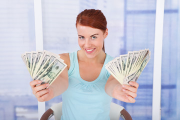 Woman Showing Dollar Bills At Home