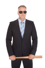 Confident Businessman Holding Baseball Bat