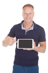 Handsome Man Displaying Digital Tablet